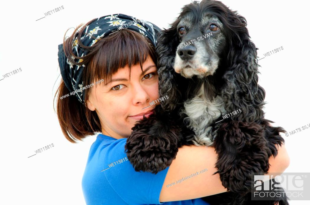 Stock Photo: Proud farmer woman holding her dog.