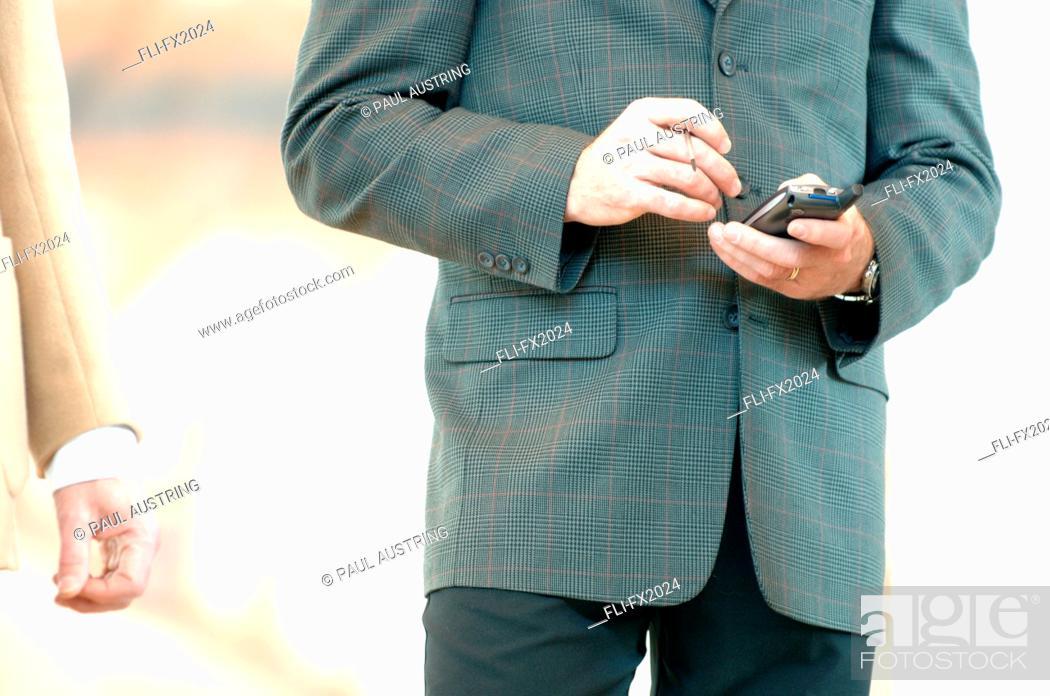 Stock Photo: Man on PDA.