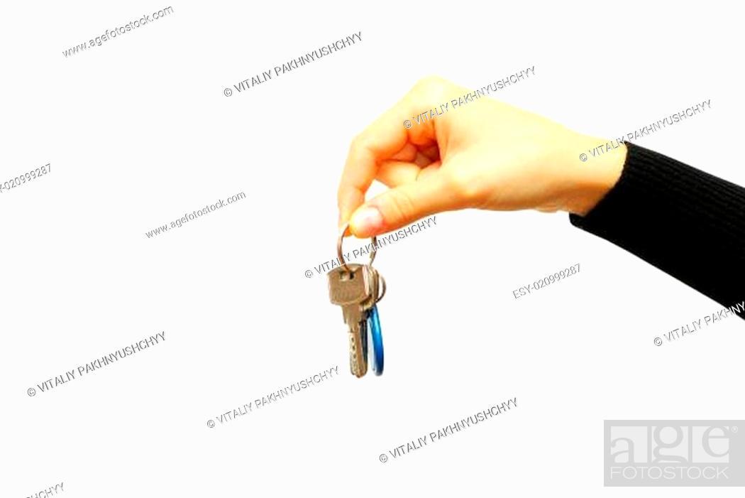 Photo de stock: hand holds a key.