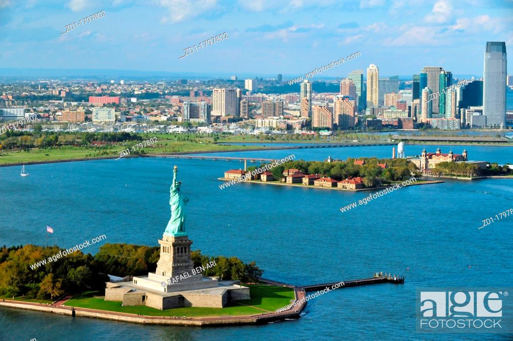 Stock Photo: An aerial view from a helicopter of the Statue of Liberty and Manhattan, New York.