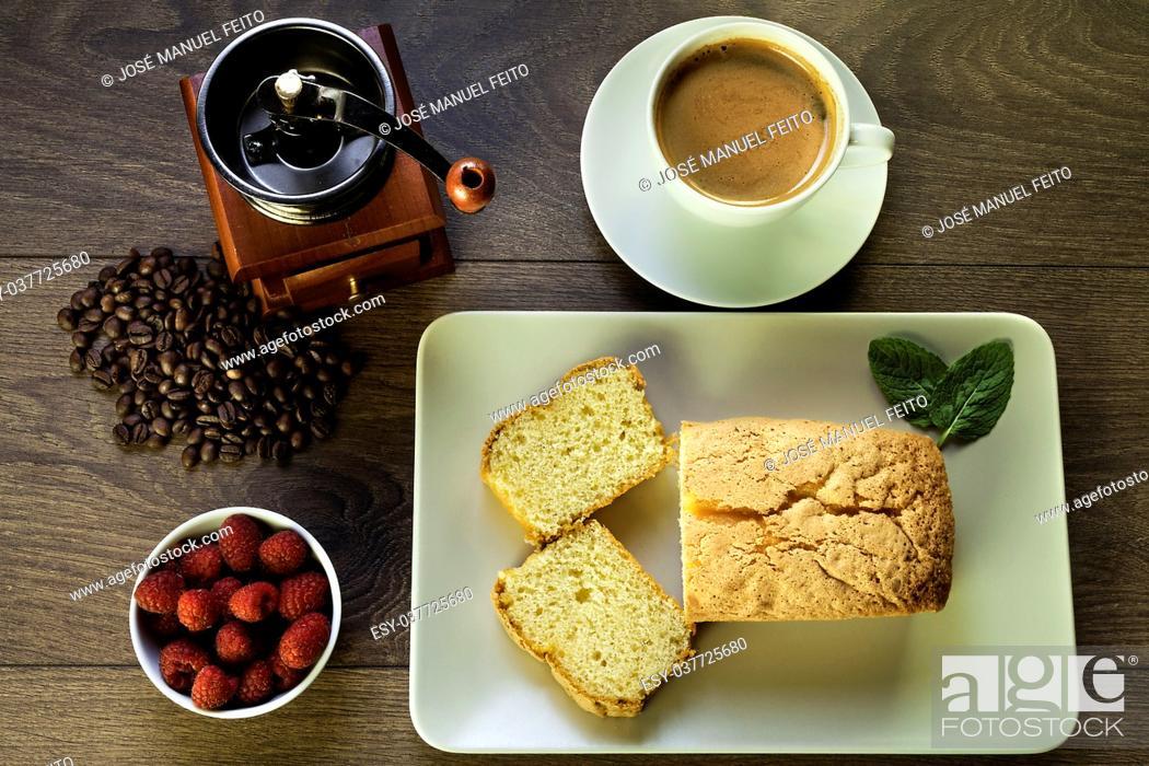 Stock Photo: sponge cake, raspberries, cup of coffee, coffee beans and coffee grinder on wood.