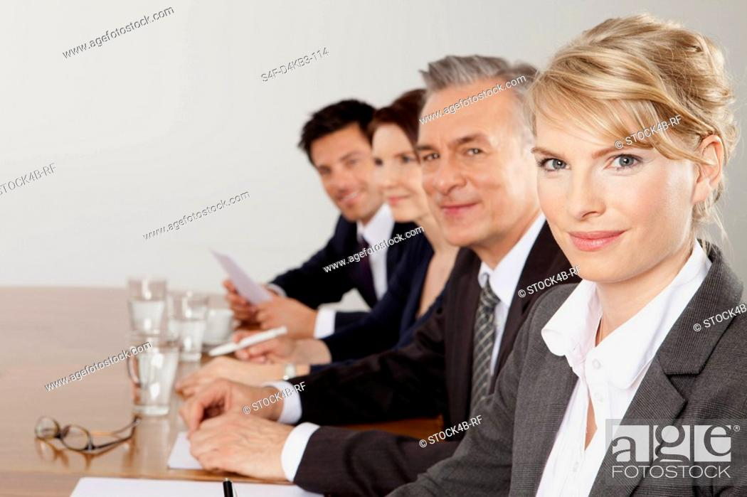 Stock Photo: Four businesspeople in conference room, Bavaria, Germany.