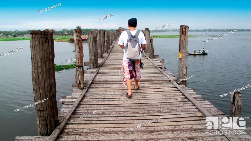 Stock Photo: Thai man travel and walking at U Bein Bridge in Amarapura, Myanmar.