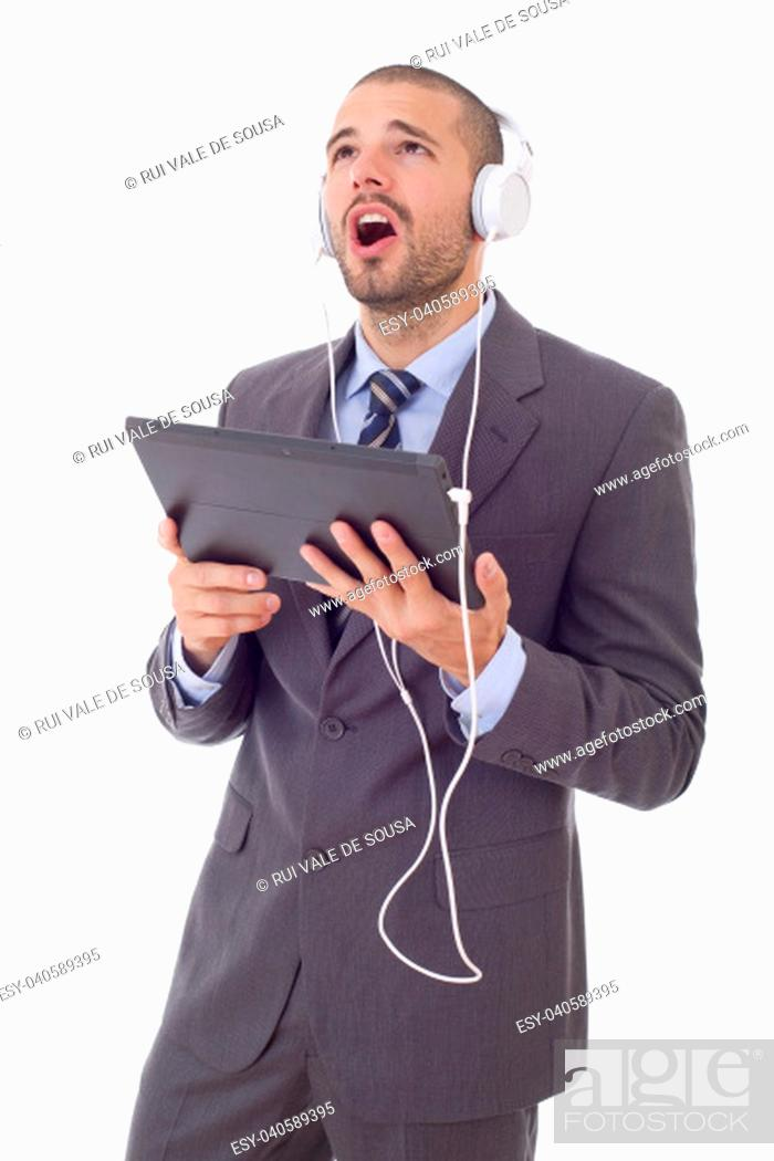 Stock Photo: happy businessman working with a tablet pc, isolated.