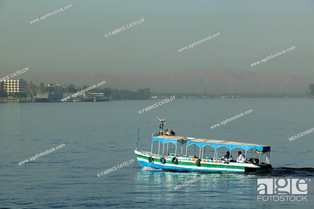 Stock Photo: Motorboat crossing the Nile.