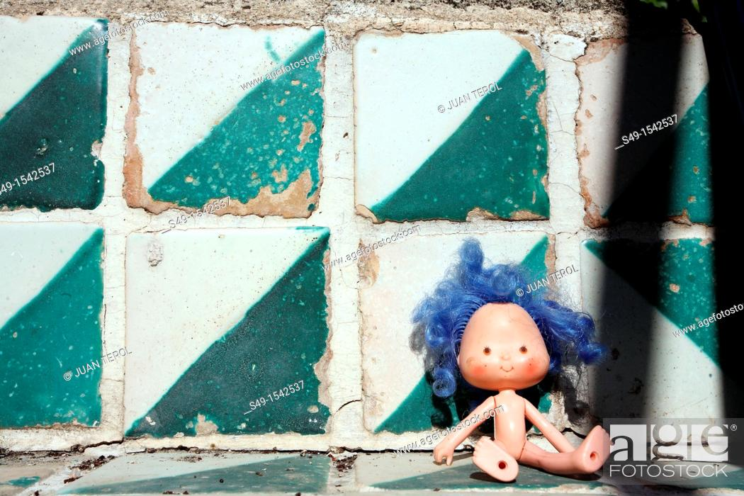 Stock Photo: Abandoned Doll Lying in Green floor.