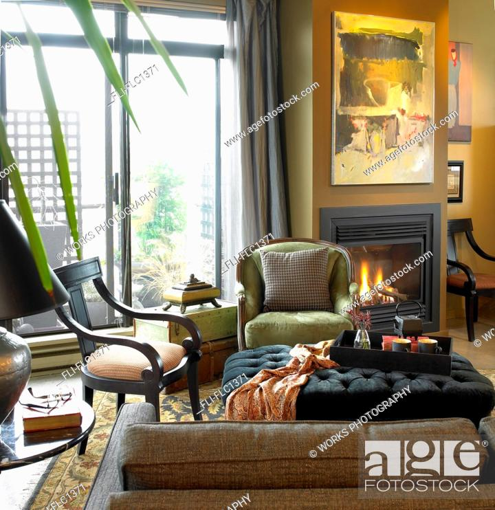 Condo Living Room With Fireplace Burning And Patio Doors Open