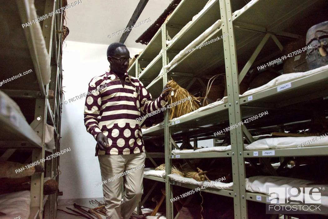 Stock Photo: 04 August 2018, Kenya, Nairobi: Dennis Opudo, head of the Anthropological Department of the Nairobi National Museum, is part of the museum's ethnographic.
