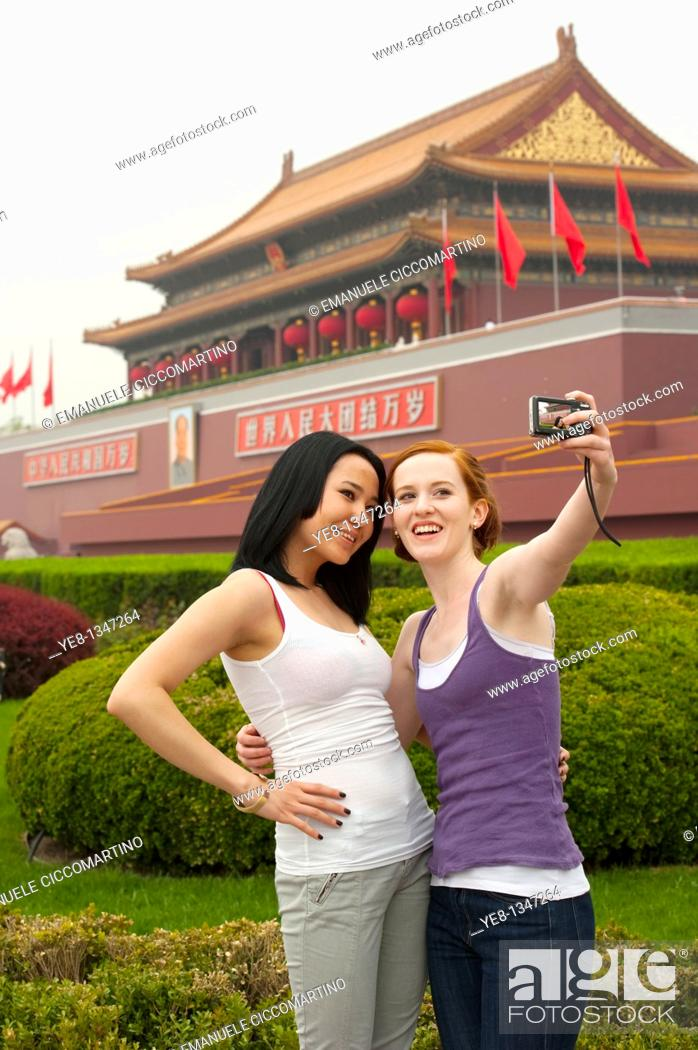 Stock Photo: Tourists taking their own photograph in front of The Gate of Heavenly Peace, The Forbidden City, Beijing, China, Asia  MR.