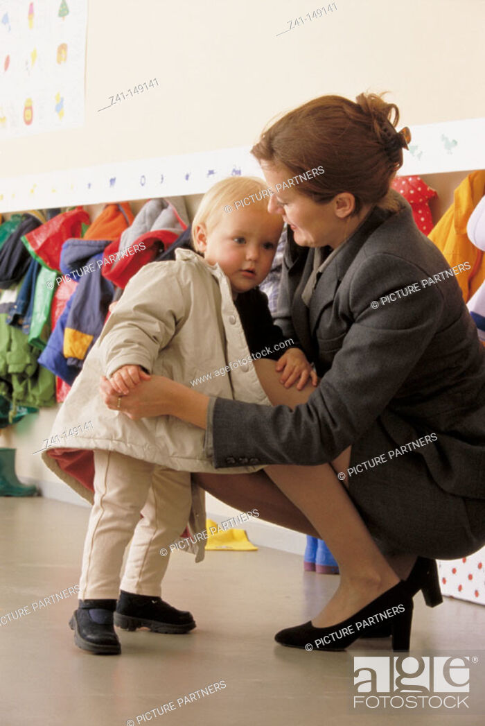 Stock Photo: Mother and daughter at day nursery.