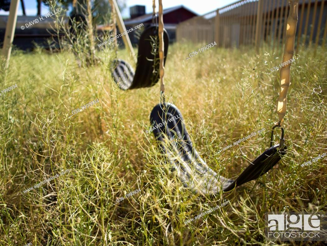 Stock Photo: Empty swings outside a foreclosed house in Mesa, Arizona, United States.