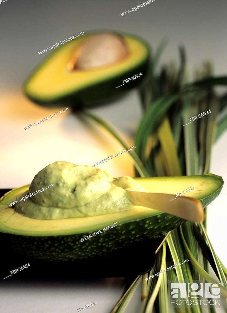 Stock Photo: Avocado half with body mask Persea americana.