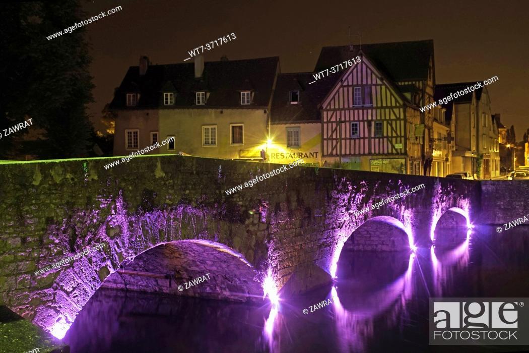 Stock Photo: Illuminated bridge and houses.