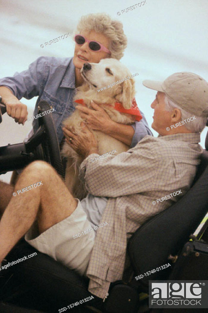 Stock Photo: Senior couple with their dog.