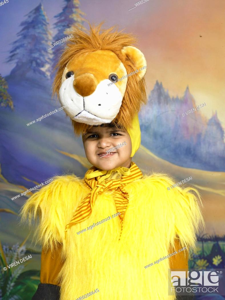 a7b6ece22d Stock Photo - South Asian Indian boy dressed as lion performing fancy dress  competition on stage in nursery school MR