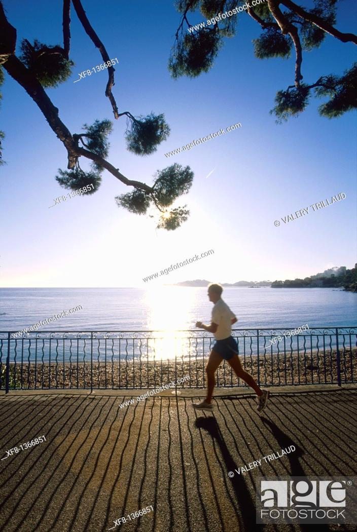 Stock Photo: Man jogging. Beaulieu sur mer, Alpes-Maritimes, French Riviera, Provence-Alpes-Cote d'Azur, France.