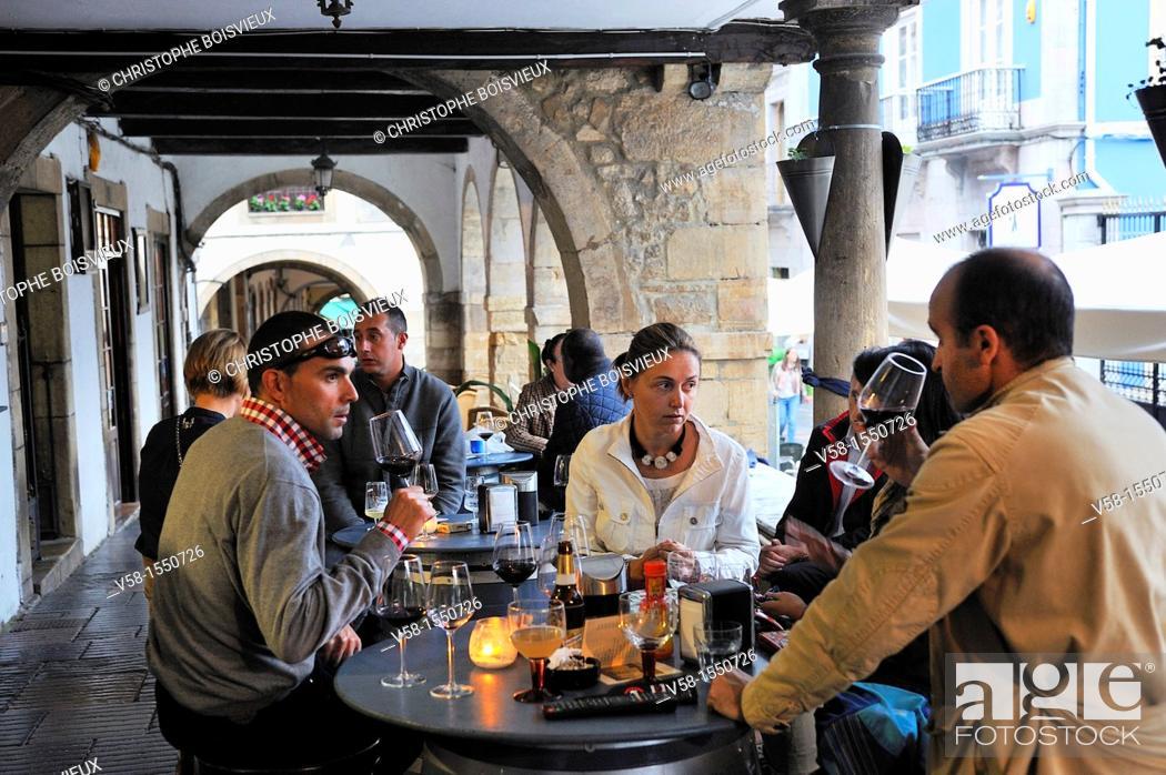 Stock Photo: Spain, Asturias, Aviles, Calle Galiana by night, Wine bar.