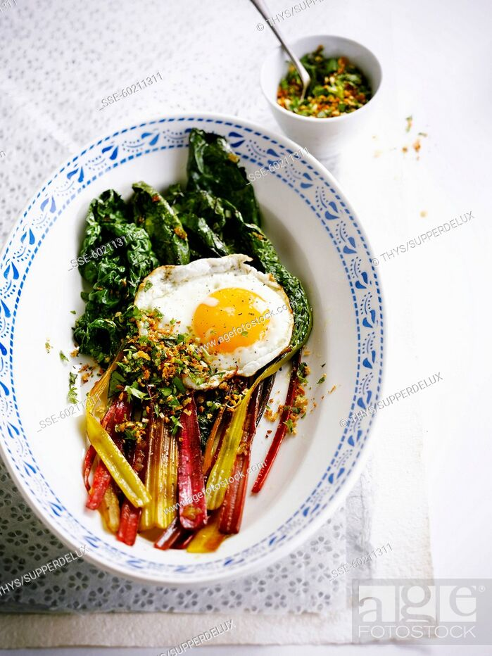 Stock Photo: Swiss chard with a fried egg.