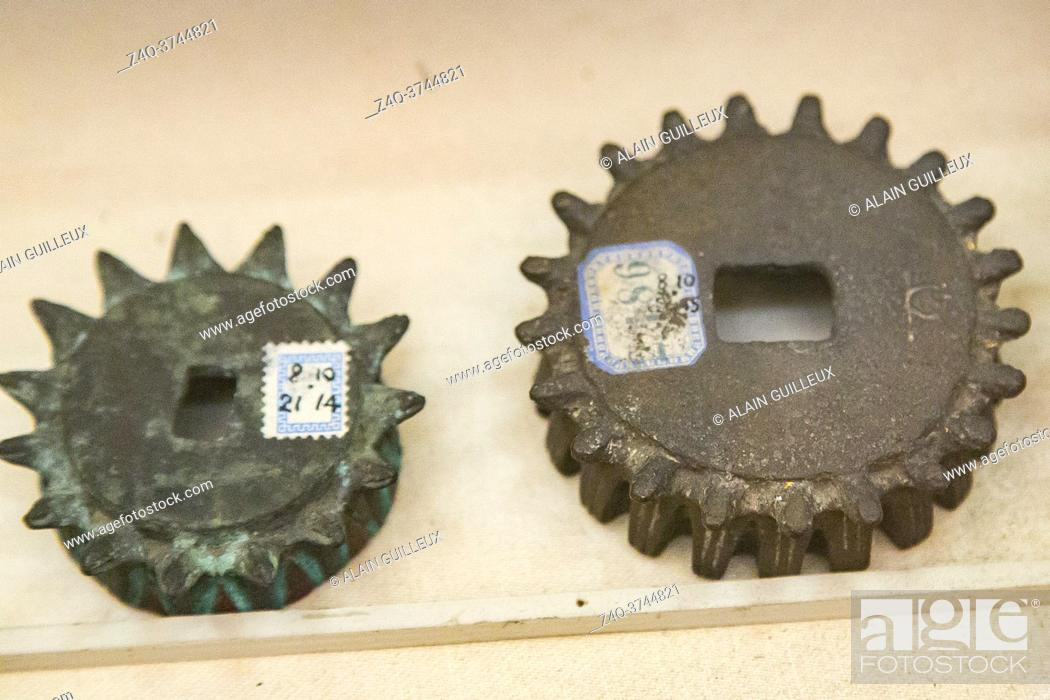 Stock Photo: Egyptian museum Cairo, objects said to be gearing. They are in fact crown frames, the gear teeth are small snakes (uraei).