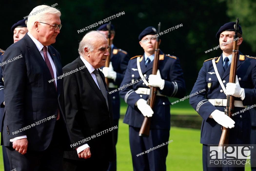 Stock Photo: 23 September 2021, Berlin: German President Frank-Walter Steinmeier (l) receives Malta's President George William Vella with military honours in the garden of.