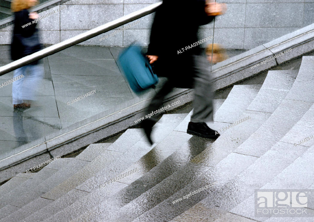 Stock Photo: Person climbing stairs, low section, blurred motion.