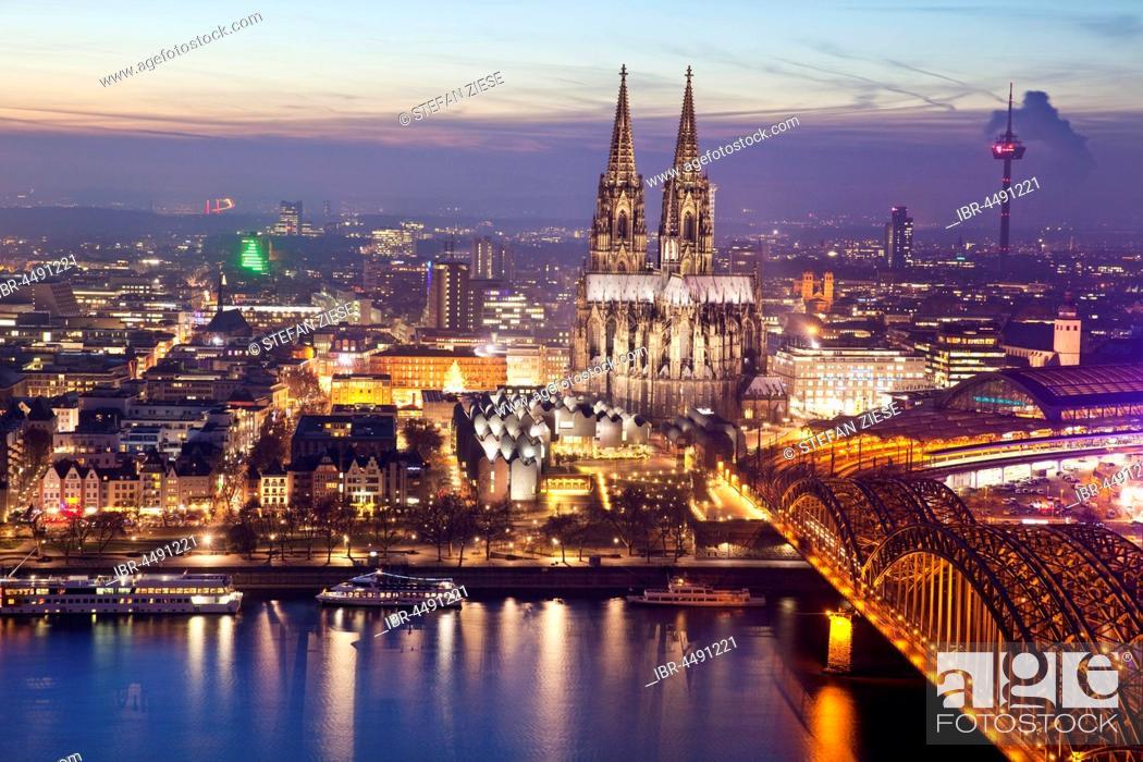Stock Photo: Cityscape with Cologne Cathedral, Hohenzollern Bridge and the Rhine at dusk, Cologne, Rhineland, North Rhine-Westphalia, Germany.