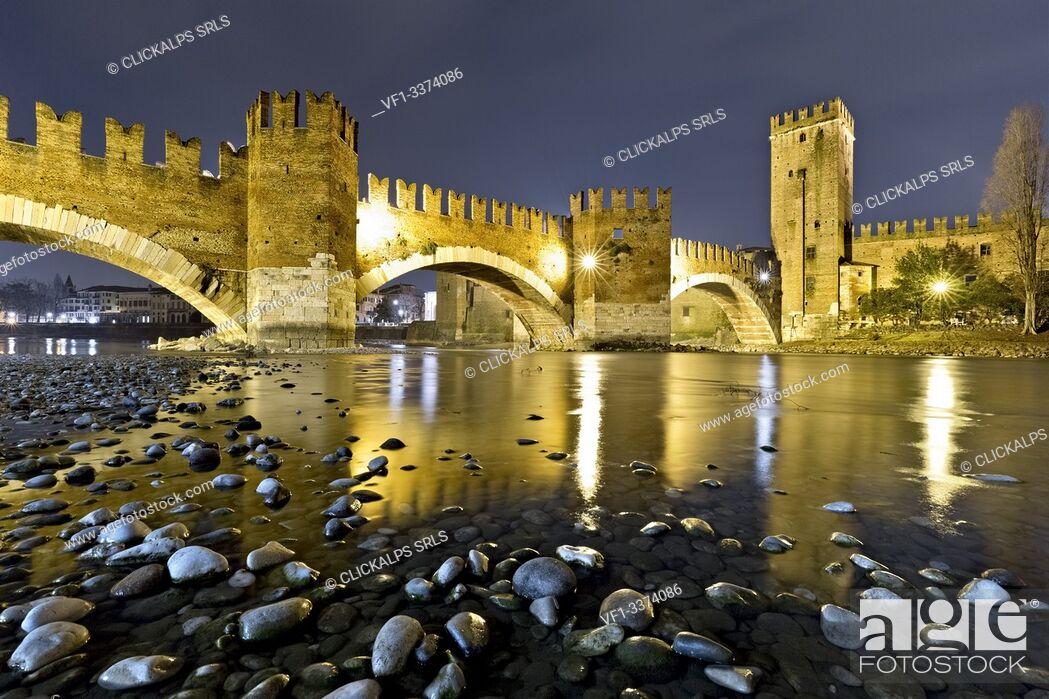 Stock Photo: The Castelvecchio and the Scaligero bridge reflected in the Adige river. Verona, Veneto, Italy, Europe.