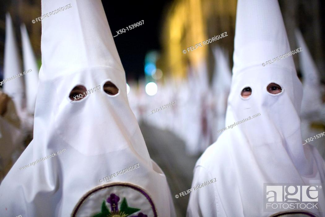 Stock Photo: Close up of young hooded penitents, Holy Week, Seville, Spain.