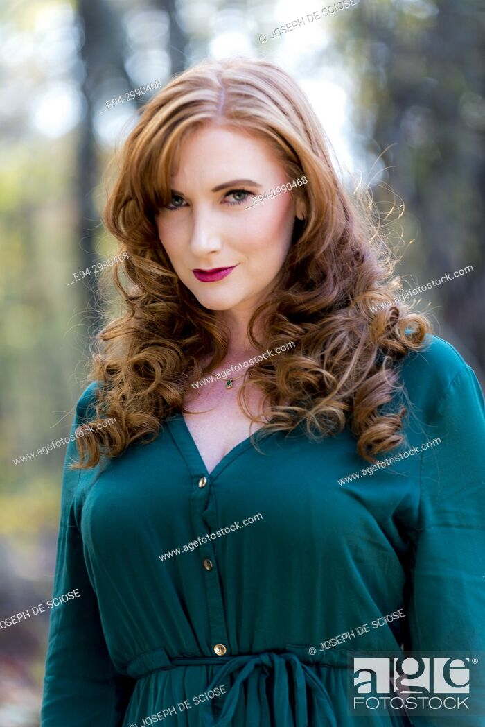 Stock Photo: Portrait of a 27 year old redhead woman outdoors.