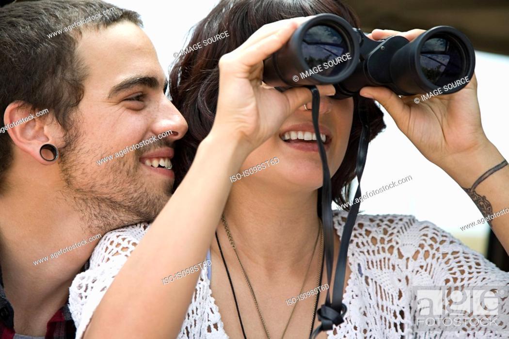 Stock Photo: Young couple with binoculars.
