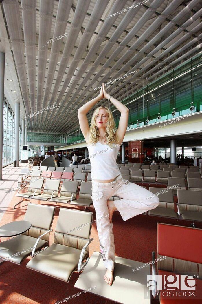 Stock Photo: 30 year old woman doing yoga.
