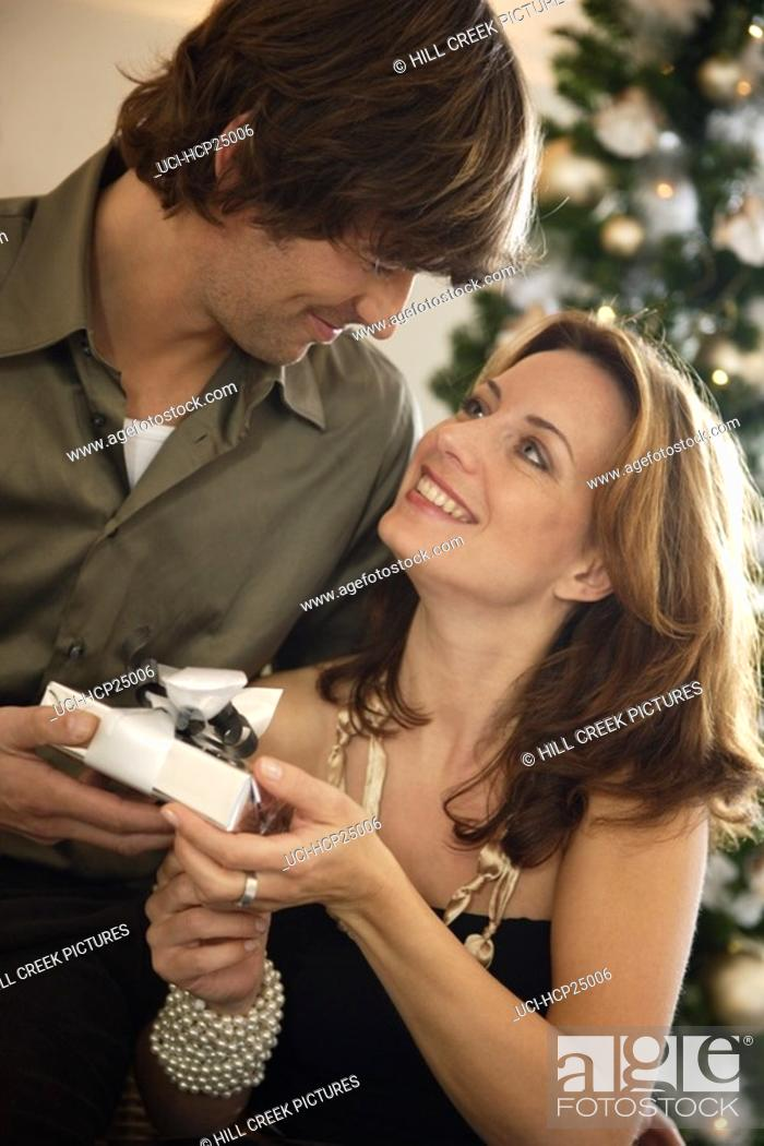 Stock Photo: Couple exchanging Christmas gifts.
