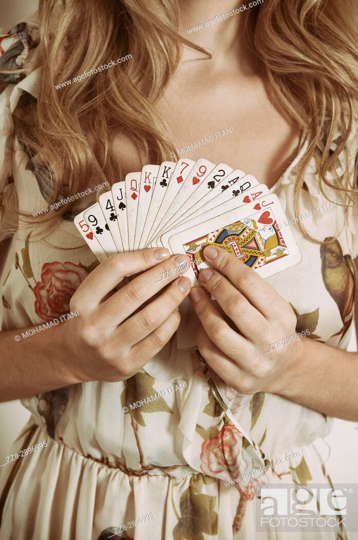 Stock Photo: Close up of a woman holding playing cards.