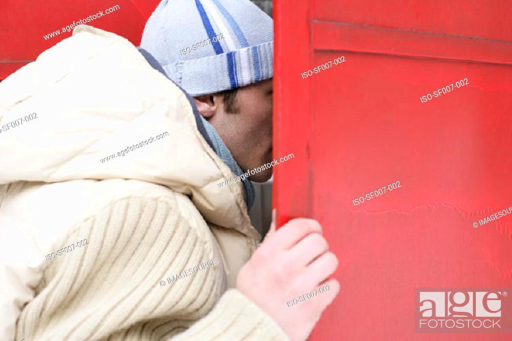 Stock Photo: Man opening shutters.