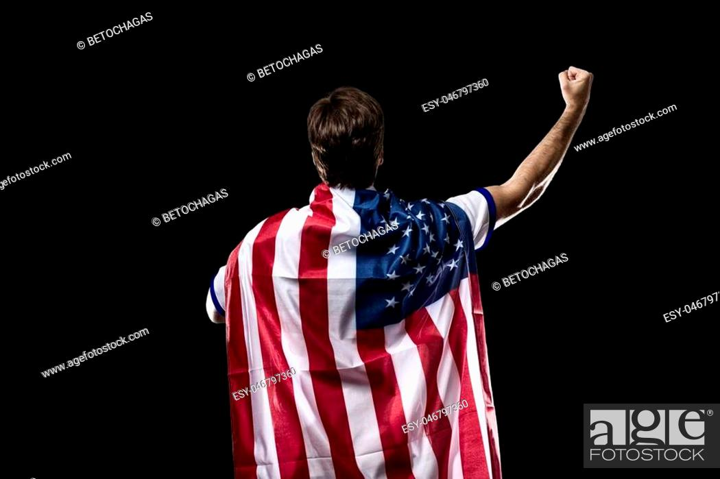 Photo de stock: American Athlete Winning a golden medal on a black Background.