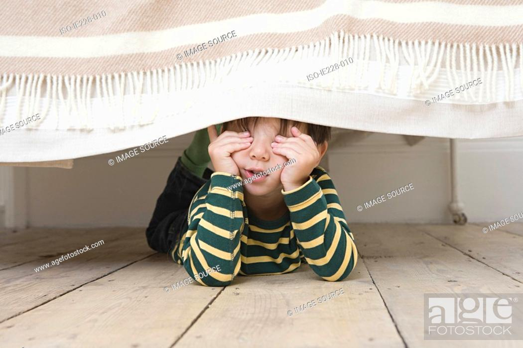 Stock Photo: Boy playing hide and seek.
