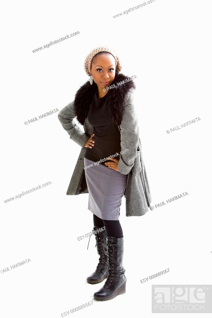 Stock Photo: Beautiful African woman wearing gray winter wear, isolated.