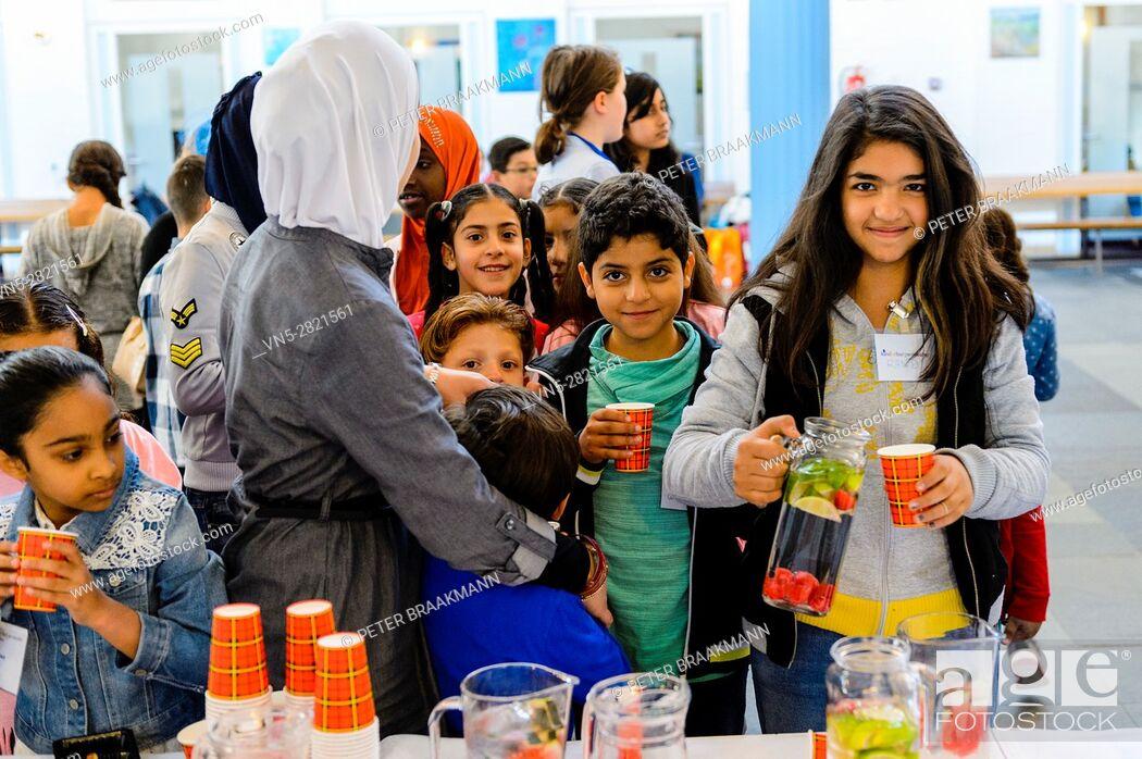 Stock Photo: AALSMEER - THE NETHERLANDS - OCTOBER 8: Mayor children welcome refugees children on the national day of children mayors on October 8, 2016 in Aalsmeer.