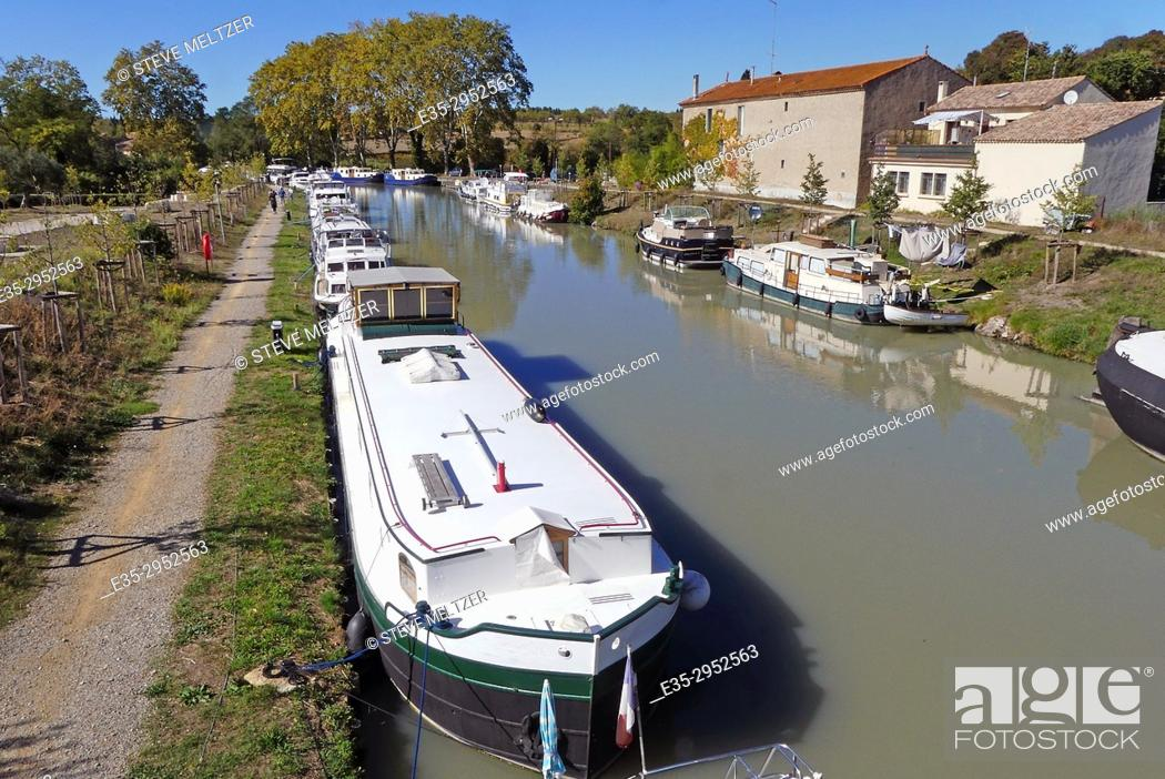 Stock Photo: Boats moored along the Canal du Midi, Capestang, France.