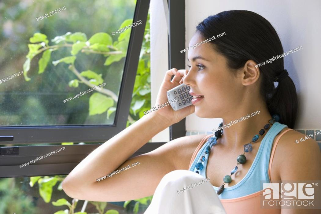 Stock Photo: Young woman talking on telephone.