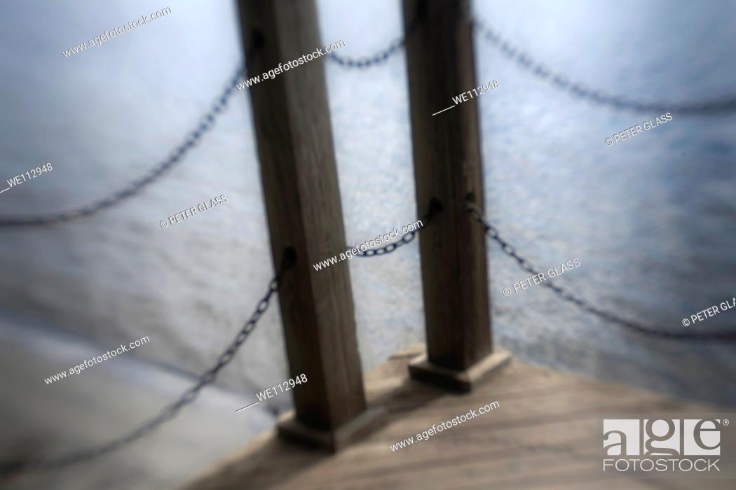 Stock Photo: Wooden beams and metal chains from a pier.
