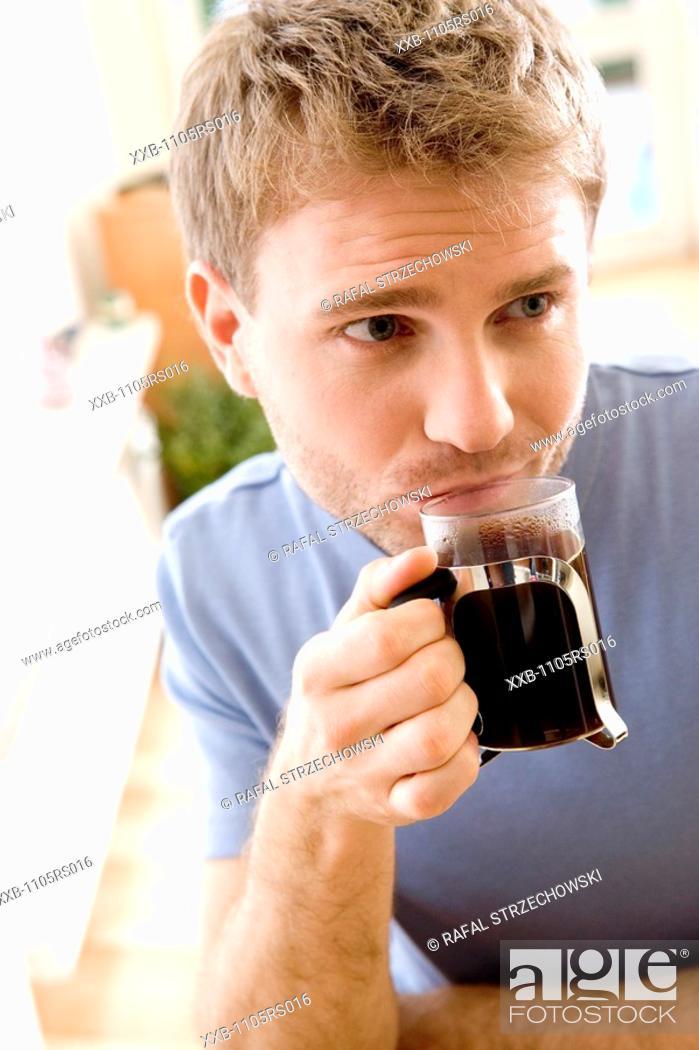 Stock Photo: man drinking black coffee.