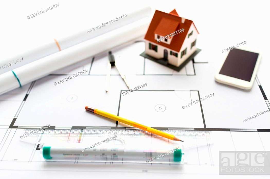 Stock Photo: architecture, building, construction, real estate and home concept - close up of blueprint with living house model and tools.