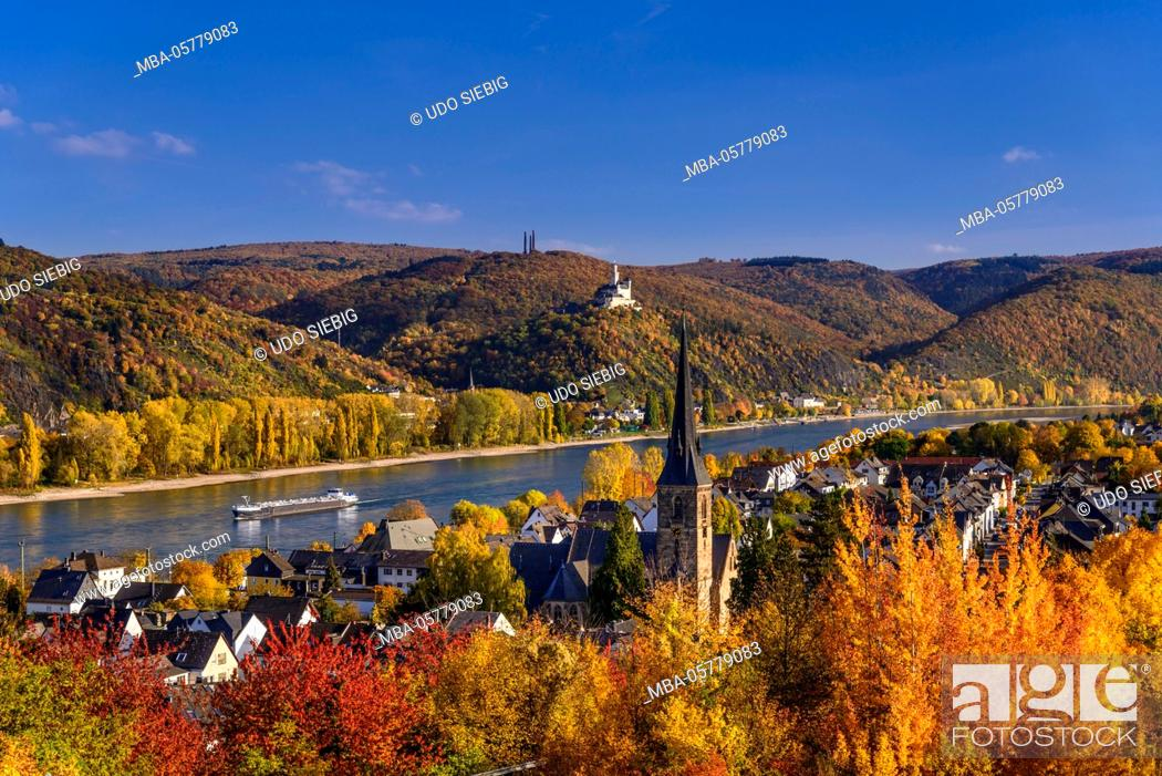 Stock Photo: Germany, Rhineland-Palatinate, upper Middle Rhine Valley, Rhens, townscape with church St. Theresia, in the background Braubach with Marksburg.