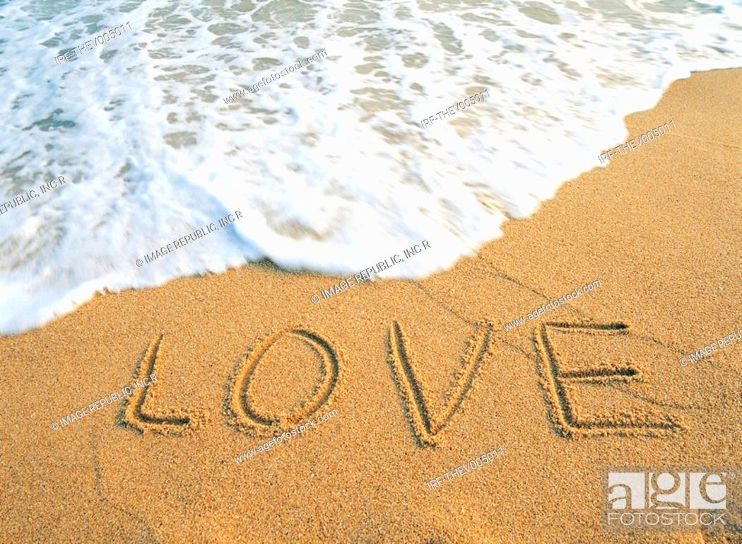 Stock Photo: LOVE on the sandy beach.