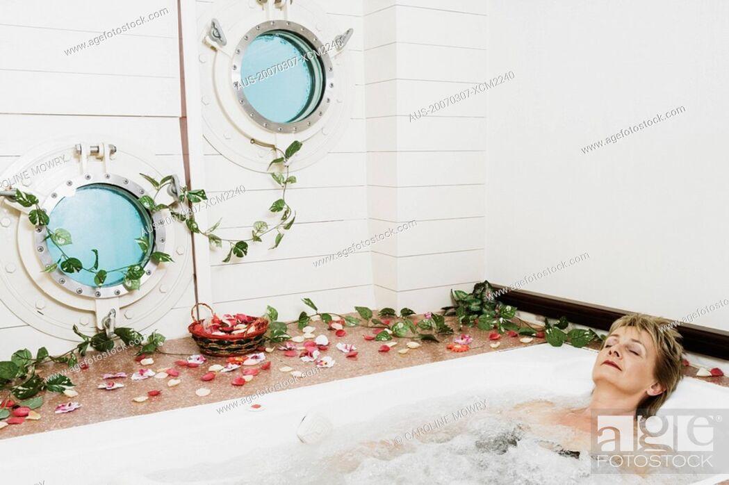 Stock Photo: Mature woman in a bathtub.
