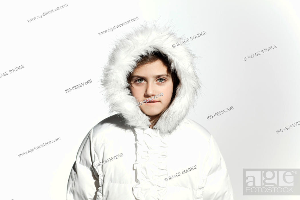Stock Photo: Girl wearing a white coat with fur hood.