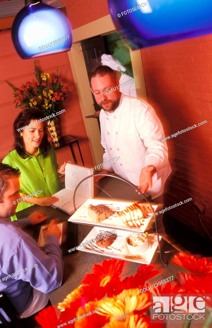 Stock Photo: Chef Showing His Food.