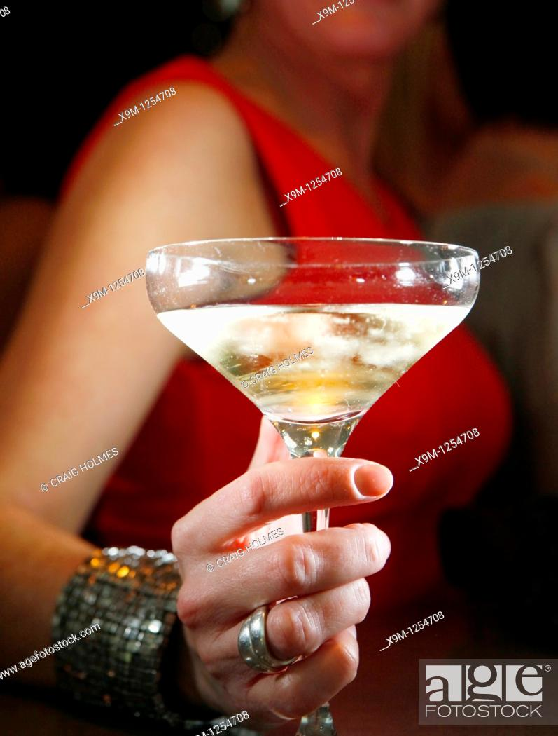 Stock Photo: Woman drinking champagne in a bar.