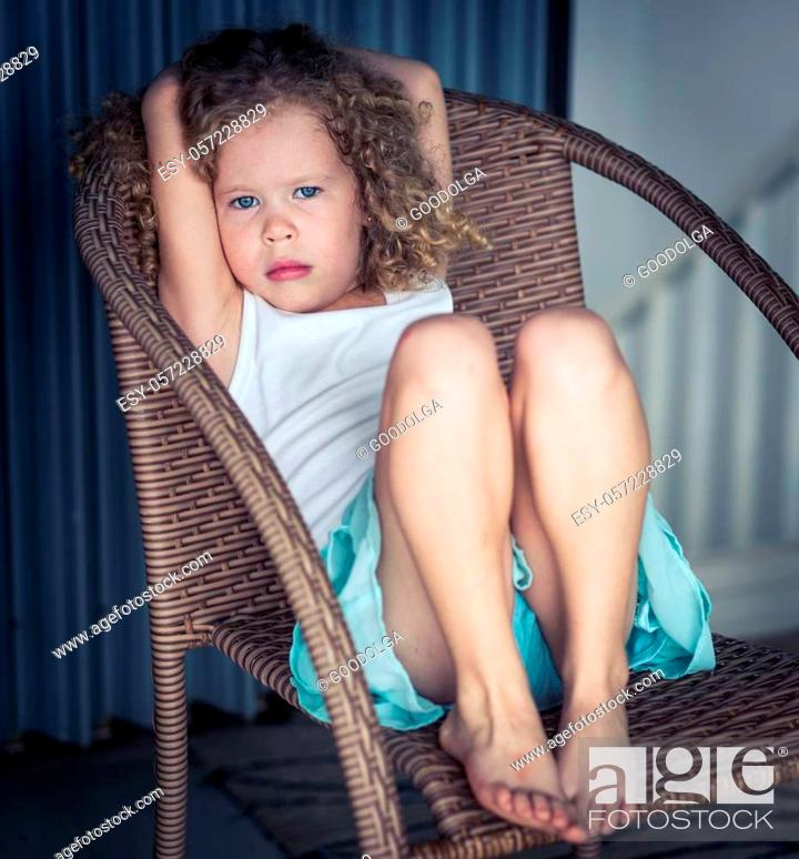 Stock Photo: Portrait of a cute girl sitting ouddoor.